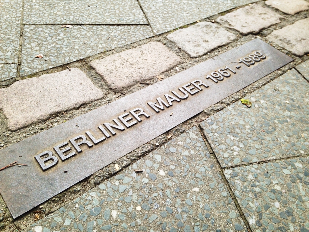 Berlin Wall cobblestone line on the pavement